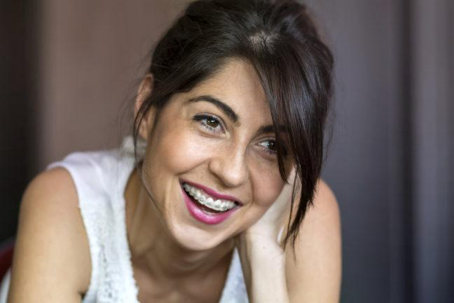 Portrait of a beautiful woman with braces on teeth. Orthodontic Treatment. Dental care Concept
